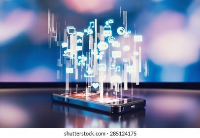 Black smartphone emitting holographic social media icons.