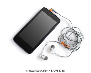 Black smartphone and headphones isolated on the white background
