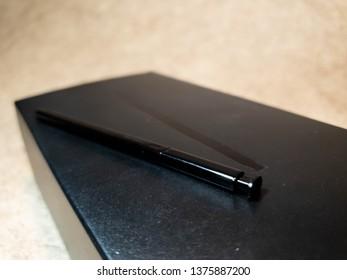Black smartphone stylus close-up. Phablet's stylus the cloe-up