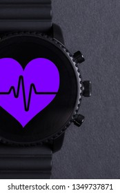 Black smartwatch isolated on a black background, heartbeat