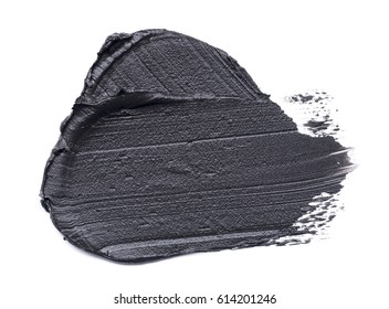 Black smear of crushed eyeliner on a white background. Texture of black crushed eyeliner isolated on white background
