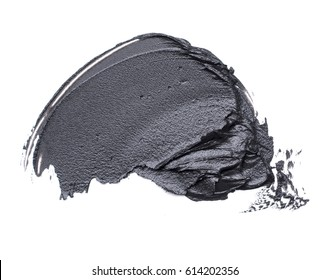 Black smear of mud mask for face on a white background.