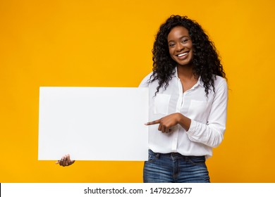 Black Smiling Woman Holding White Blank Card, pointing at blank