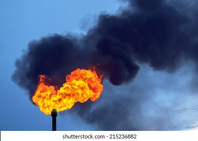Black smoke from burning of associated gas