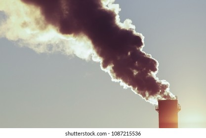Black smoke comes out of the chimney at the factory