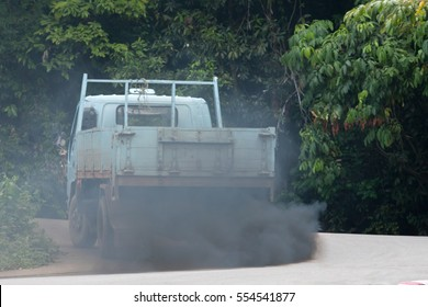 black smoke from the exhaust pipe of a truck