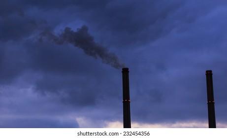 Black smoke spewed from coal powered plant smoke stacks