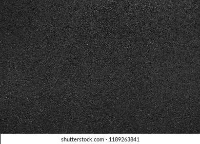 Black smooth asphalt road texture background top view