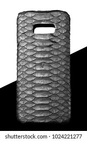 black snake leather case for smartphone. On black and white background