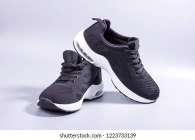 black sneakers on gray background