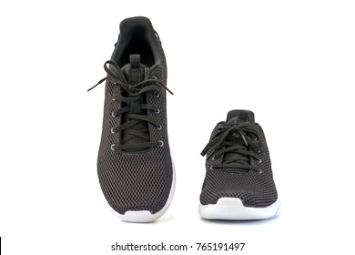 Black sneakers running shoes isolated on white background, with clipping path.
