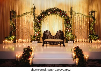 Black sofa for Hindu wedding creremony stands on the stage