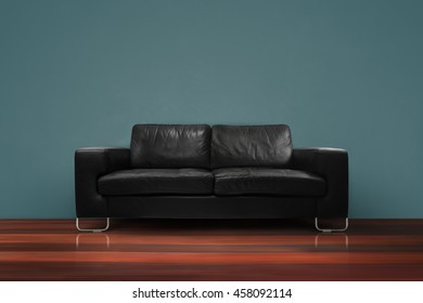 Black sofa with wooden floor dark green concrete wall in empty living room interior loft style