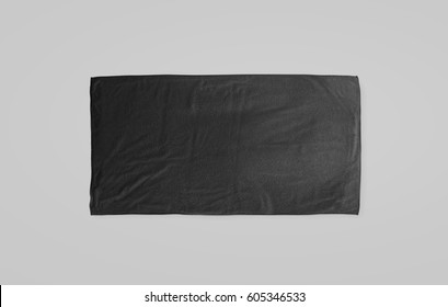 Black black soft beach towel mockup. Dark unfolded wiper mock up laying on the floor. Shaggy fur bath textured jack-towel top view. Domestic cloth kitchen overlay template ready for print.