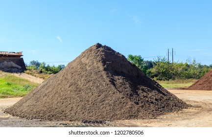 Black Soil Mound:  Mound of black Soil used for landscaping and driveways on display and for sale.