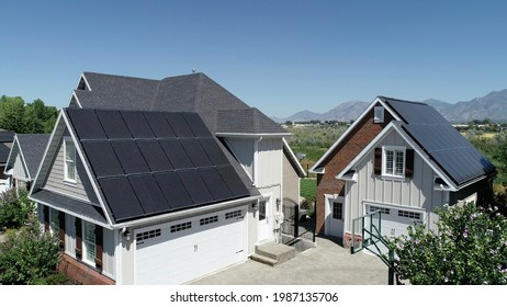 Black solar panels on roof of home. Electricity reduced from high quality black solar panel installation