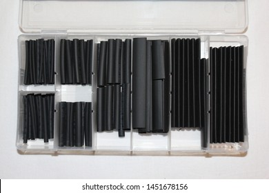 black sorted shrinking tubes, close, tools