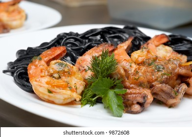 black spaghetti with fried seafood