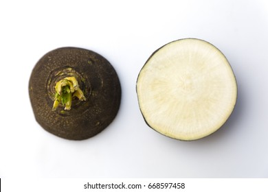 Black Spanish Radish on white, top view. Black Radish top view cut in half.