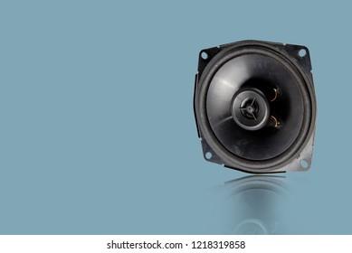 Black speaker isolated from white background.