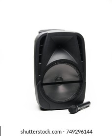 Black Speaker with microphone on a white background.
