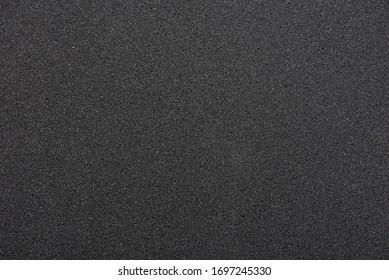 Black sponge texture. foam rubber background.
