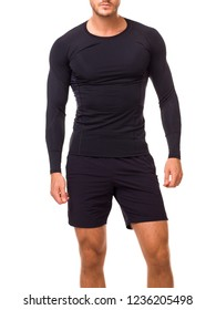 Аthlete in a black sports long sleev shirt. Sportive young man in a black t-shirt, sturdy figure, athletic tight-fitting t-shirt and a confident posture.