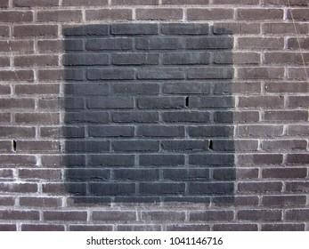 A black square on a brick stone wall i.m. Malevich