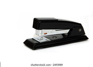A Black stapler isolated against a white background