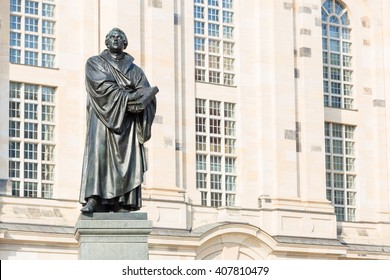 The black statue of Martin Luther in front of the church Frauenkirche in Dresden, Germany