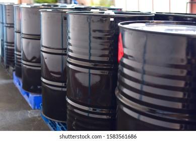 Black Steel Chemical Drums or Barrels on Pallets