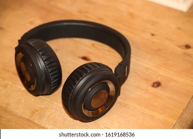 Black stereo headphones on a table