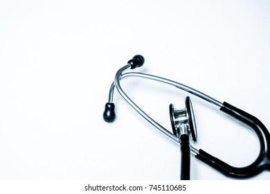 A black stethoscope on white background.