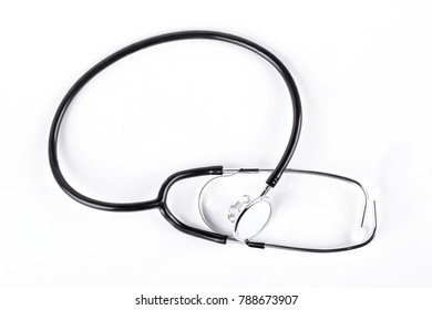 Black stethoscope on white background. Medical metal instrument for health examination.