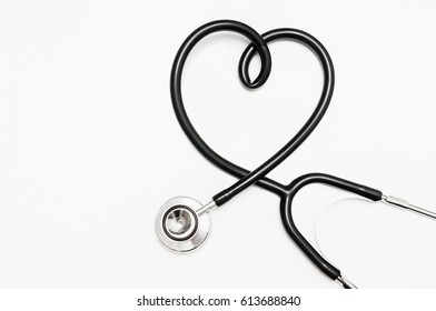 Black stethoscope in shape of heart isolated on white background