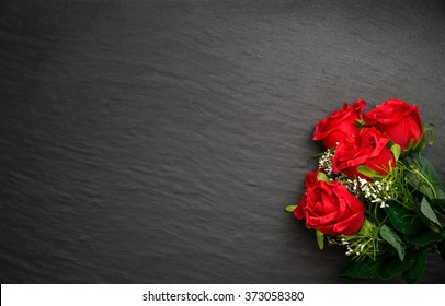 black stone background with colored flowers