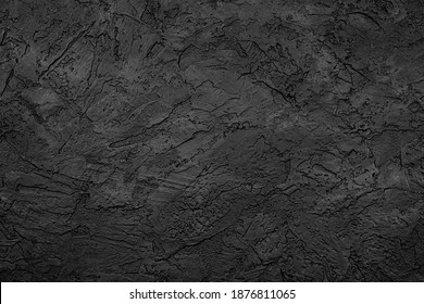 Black stone background texture. Black stone plaster cement. Grunge wall. Graphite