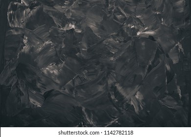 Black stone background. Top view. Free space for text.