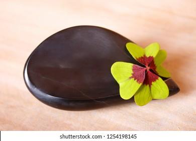black stone with cloverleaf