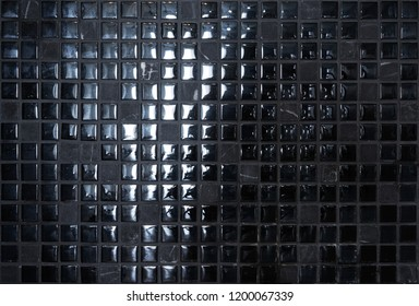 Black stone and shiny mosaic wall background - Shutterstock ID 1200067339