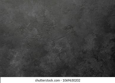Black stone or slate background or texture, horizontal
