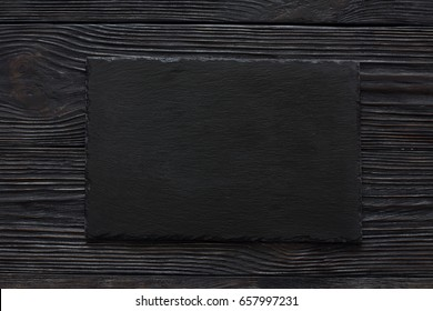 Black stone slate background texture. Top view