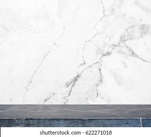 Black stone table top and background of white marble stone wall - can used for display or montage your products.