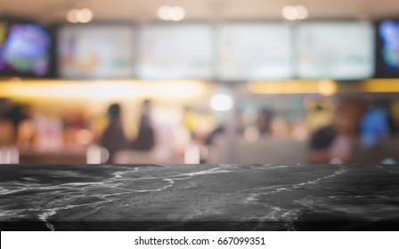 Black Stone table top and blurred restaurant interior background with vintage filter - can used for display or montage your products.