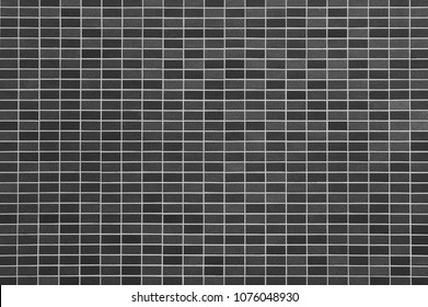 Black stone tile wall semaless background and pattern