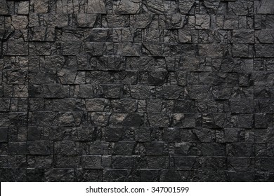 black stone wall background or texture