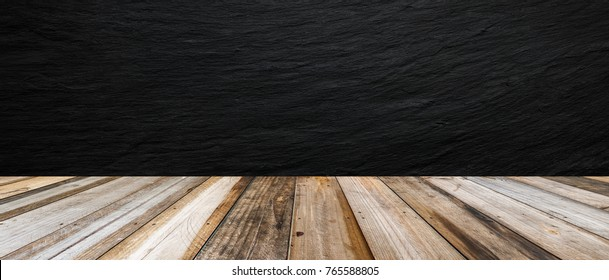 Black stone wall background and wood table