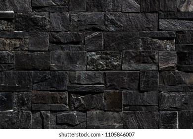 Black stone wall seamless background