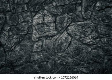 Black stone wall texture. Dark sinister Gothic background