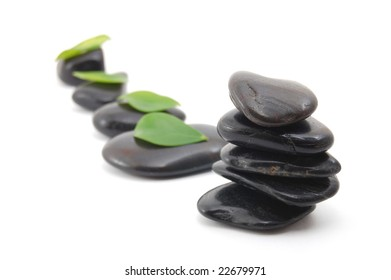 black stones in balance isolated on white background